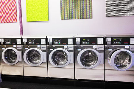 Undergo a laundry lift part 2 american coin op kuskin explains that the wall decorations shes installed in her store not only make the space bright and cheery during the spring and summer but can solutioingenieria Image collections