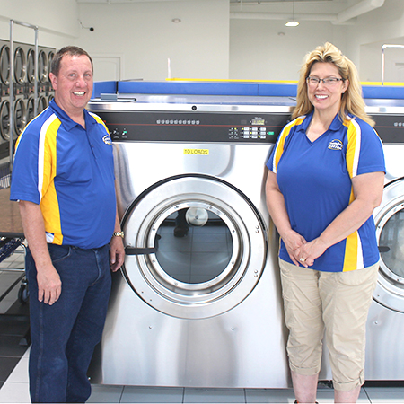 Sharon Brinks and husband Steve pose inside The Laundry Station